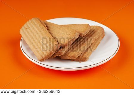 Delicious Delicious Ginger Cookies On A White Saucer