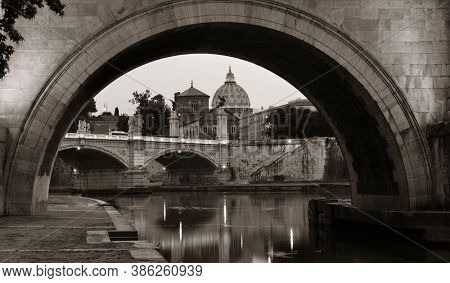 River Tiber in Rome with Vatican City St Peters Basilica,  Ponte Vittorio Emanuele II and Ponte Sant Angelo