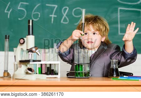 Learn For Future. Biology Science. Testing Tubes With Liquid For Research. Small Boy Use Microscope