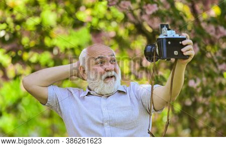 Everyone Photogenic. Senior Man Taking Selfie Photo Vintage Camera. Self Portrait. Memories In Snap.