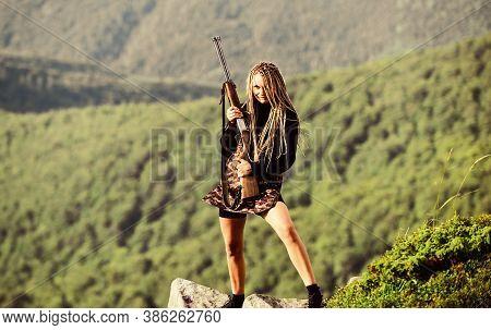 Dangerous Girl. Defending Concept. Warrior Mountains Landscape Background. Feminist Girl. Hunting Se
