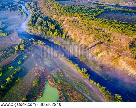 Aerial View To Foggy Valley With River Siverskyi Donets And Zmiiv Hills With Withered Grass, Calm Au