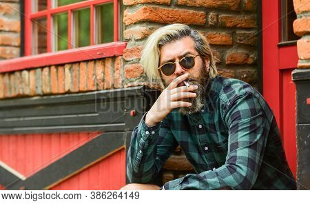 Hipster Smoking Old Architecture Background. Medical Cannabis. Smoking Habit. Fashionable Mature Man