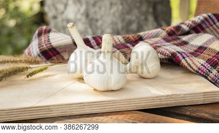 Garlic. Sliced Garlic, Garlic Clove, Garlic Bulb In Wooden Bowl Place On Chopping Block On Vintage W