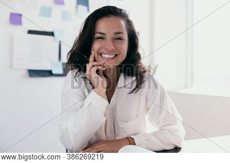 Excited Caucasian Woman With Brown Hair Sit At Desk Feeling Euphoric And Looking At Camera. Office O
