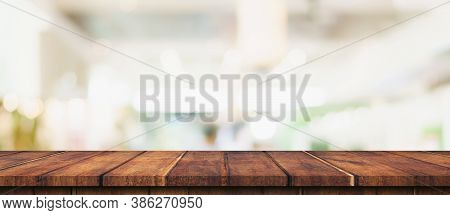 Empty Wood Table And Blurred Light Table In Shopping Mall With Bokeh Background. Product Display Tem