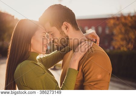 Photo Of Affectionate Students Couple Hug Under Sunshine Fall Sky In September Town Park Wear Turtle