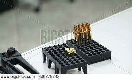 Shotgun Cartridges Close-up Shot Of Shotgun Shells In Ammo Box.