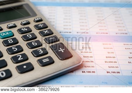 Spreadsheet Table Paper With Calculator. Finance Development, Banking Account, Statistics Investment