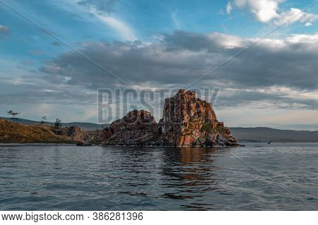 Red Cape Shamanka Rock In Lake Baikal, Background Clouds, Sunset, Reflection, Ripples, Blue Sky