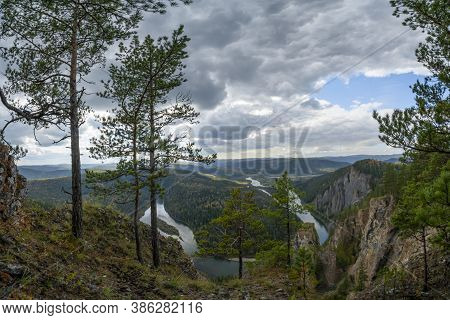 Siberian Nature - Dark Sky, Green Fields, Textured Sky And Mountains. Beautiful View From The Top Of