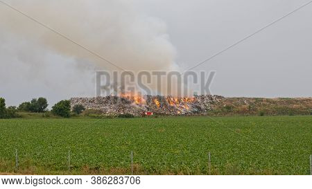 Landfill Garbage Fire Inferno With Heavy Smoke