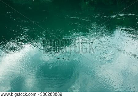Saturated Turquoise Water Surface With Ripple, Nature Coloured Background