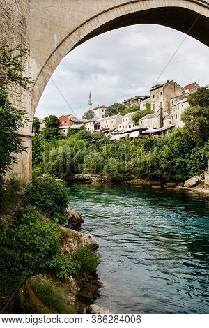 Old Bridge In Mostar On Neretva River, City Of The Federation Of Bosnia And Herzegovina. European Ol