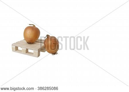 Close Up Of Two Ripe Fresh Bulb Onions On Wooden Mini Pallet Isolated On White Background With Large