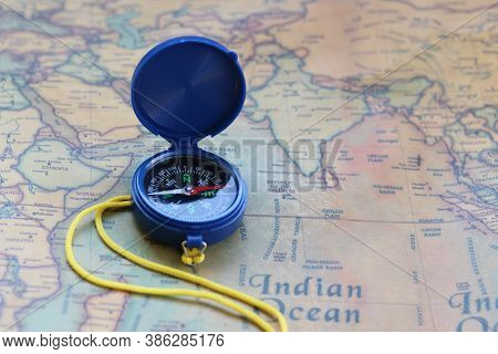 Classic Round Compass On Background Of Old Vintage Map Of World As Symbol Of Tourism With Map And Co