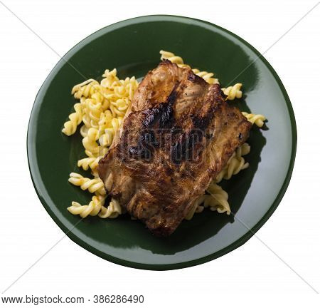 Grilled Pork Ribs With Pasta. Grilled Pork Ribs On Dark Green Plate Isolated On White Background. Gr