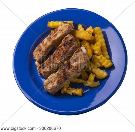 Grilled Pork Ribs With French Fries On Blue Plate. Pork Ribs With French Fries On A White Background