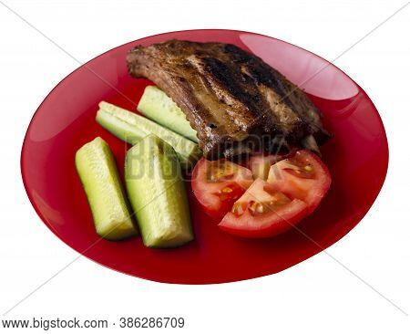 Grilled Pork Ribs With Sliced Cucumbers And Tomatoes On Red Plate. Pork Ribs Isolated On White Backg