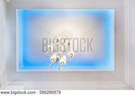 Suspended Ceiling With Neon Spots Lamps And Drywall Construction In Empty Room In Apartment Or House