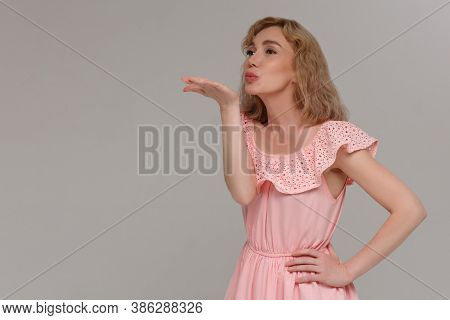 Beautiful Woman With Makeup And Blonde Hair Blows Kiss, Demonstrates Her Good Feelings, Says Goodbye