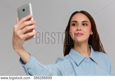 Beautiful Young Woman Is Making Selfie Photo With Smartphone.