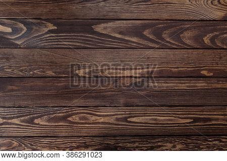 Dark Wood Background With Horizontal Planks And A Pronounced Wood Texture. Wooden Background Made Of