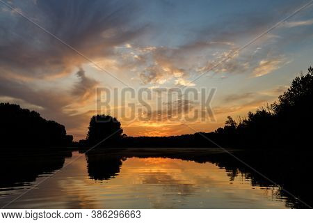 Sunset Over Wetland Of Danube River With Mirror Reflection In Water Surface, Slovakia