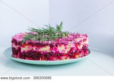 Russian Salad , Herring Under Fur Coat. Traditional Herring Salad With Beetroot, Carrot, Eggs, Potat