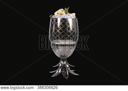 Fresh Pina Colada Cocktail Decorated With A Cherry And Sliced Pineapple In A Glass, Isolated On Blac