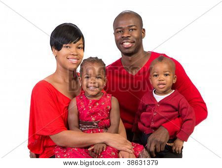 Portrait of Happy Smiling African American Family Wearing Holiday Outfits Isolated on White Background