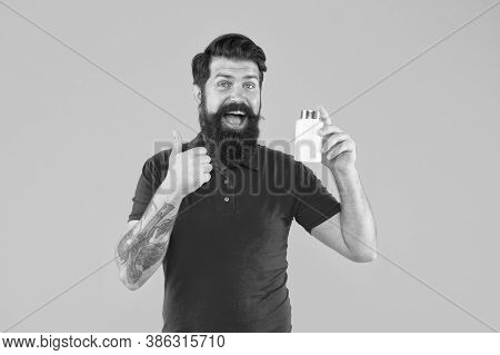 Vitamin Complex. Handsome Bearded Man Take Medication. Health Care. Side Effects. Medicines Concept.