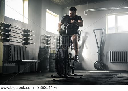 Sportive Man Train Legs On Stationary Bike .