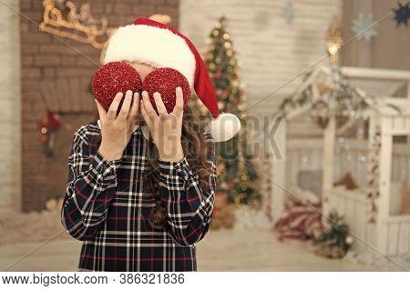 Playful Kid. Kid Santa Hat Decorating Christmas Tree. Decorating Her Favorite Activity. Decor Shop.