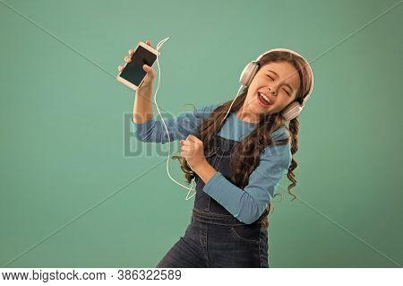 Music Application. Best Music Apps For Free. Enjoy Perfect Sound. Girl Child Listen Music Modern Hea