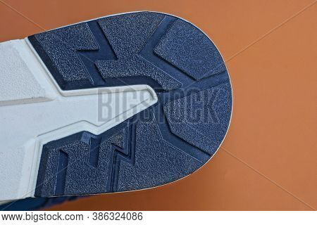 Part Of The Sole On The Shoe From A White Black Pattern On A Brown Background
