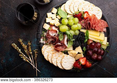 Cheese Platter For A Holiday Entertainment On Dark Background