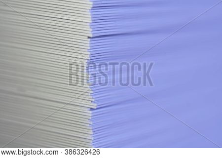 A Right Vertical Corner Of A Stack Of Many Sheets Of Thick Paper Or Cardstock. One Of The Sides Is B