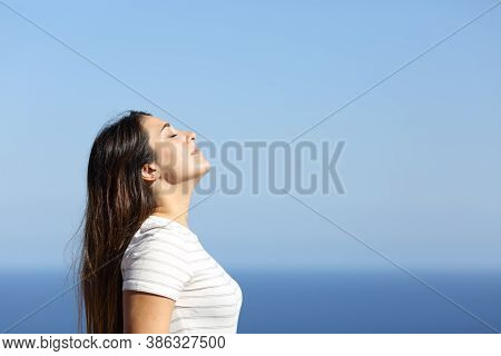 Woman Profile Breathing Fresh Air On The Beach On Summer