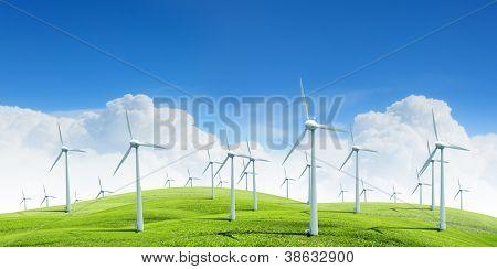 Alternative energy.  Group of energy-producing windmills agains blue sky