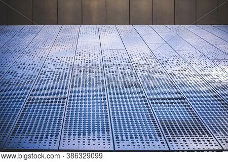 Metal Surface With Round Different Sizes Holes For Ventilation. Diminishing Perspective Of Textured