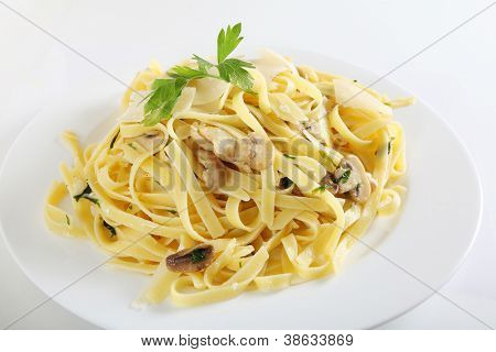 Ribbon pasta with mushrooms and italian parsley, fettuccine ai funghi, topped with curls of parmesan reggiano