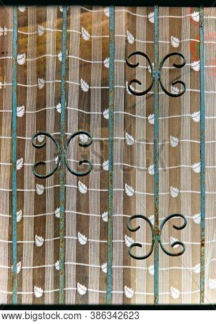 An Abstract Of Window Showing Patterns Of Curtain & Grills In Darjeeling.