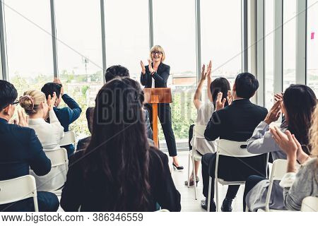 Group Of Business People Meeting In A Seminar Conference . Audience Listening To Instructor In Emplo