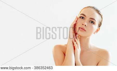 Skincare Procedure. Aesthetic Cosmetology. Portrait Of Sensual Woman With Nude Makeup Bare Shoulders