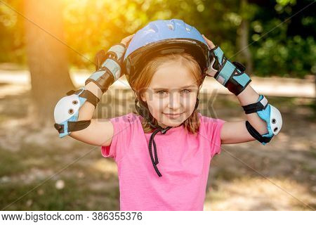 Little girl in sport protective equipment