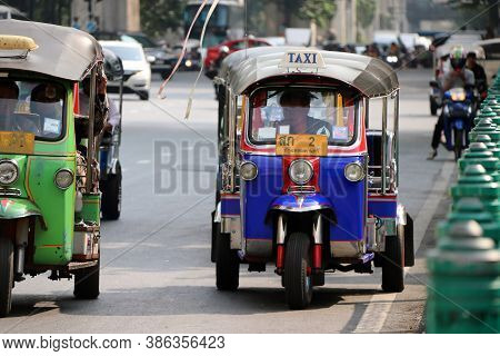 Bangkok, Thailand Feb 1, 2018: Tuk Tuk Is A Three-wheeled Motorized Vehicle Used As A Taxi Are Waiti