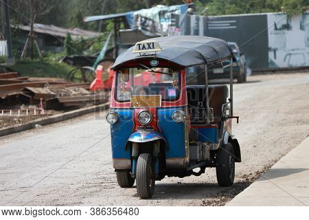 Tuk Tuk Is A Three-wheeled Motorized Vehicle Used As A Taxi, Waiting For Passengers On The Road.