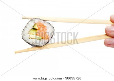 Fingers holding maki sushi roll with chopsticks, isolated on white
