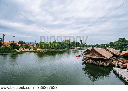 Wooden Houseboat On The River Kwai In Kanchanaburi, In Thailand